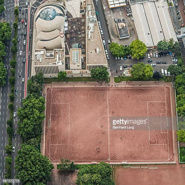 Aerial view of soccer field next to mosque