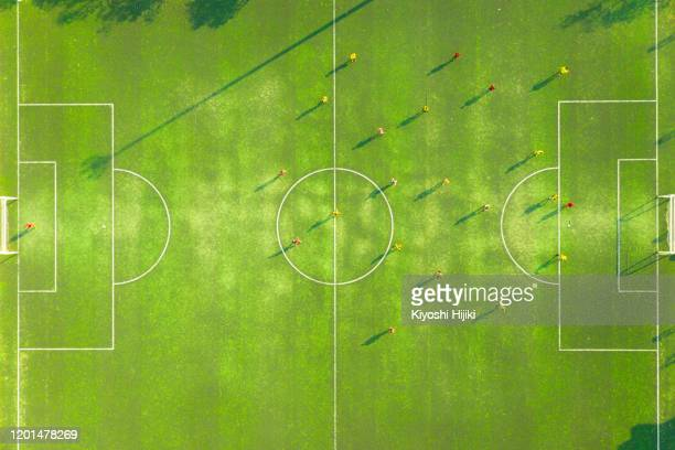 aerial view of soccer field or football field with motion of prayer in match. top view - soccer competition stock pictures, royalty-free photos & images