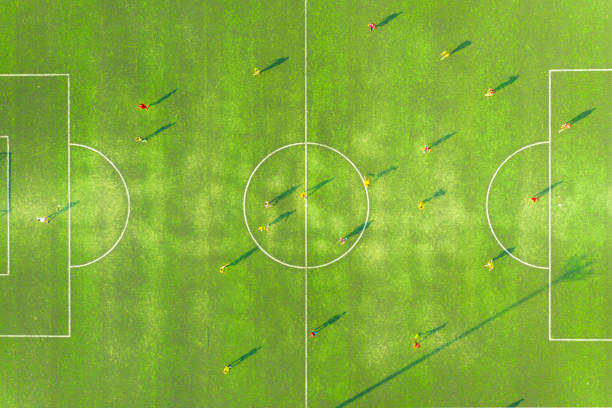 Aerial view of soccer field or football field with motion of prayer in match. top view