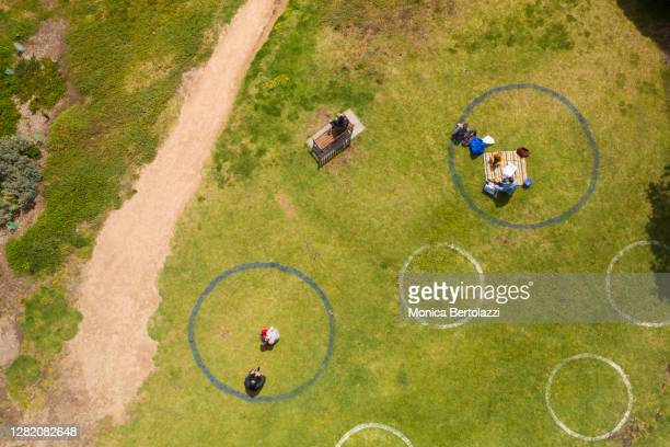 aerial view of social distancing circles marked in melbourne parks during covid 19 - epidemic stock pictures, royalty-free photos & images