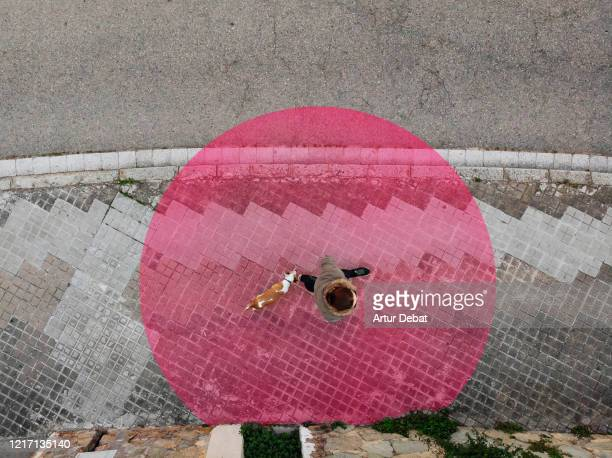 aerial view of social distancing in the street with red circle around person. - state of emergency stock pictures, royalty-free photos & images