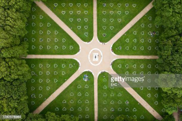 aerial view of social distancing markers in park in bristol, england - flatten the curve stock pictures, royalty-free photos & images