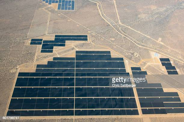 aerial view of solar farm in remote landscape - solar powered station stock pictures, royalty-free photos & images