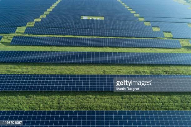 aerial view of solar farm with solar panels. bavaria, germany. - steuerpult stock-fotos und bilder