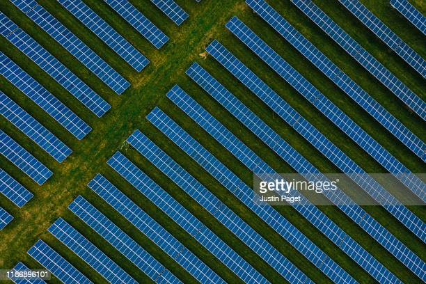 aerial view of solar panel farm - solar equipment stock pictures, royalty-free photos & images