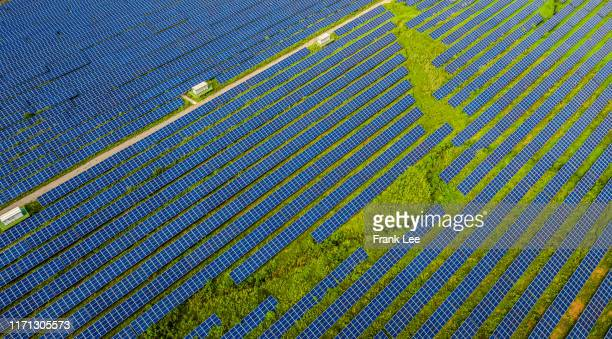 aerial view of solar power station and solar energy panels - zhejiang province stock pictures, royalty-free photos & images