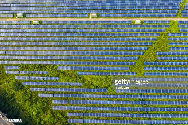 aerial view of solar power station and solar energy panels - power supply stock pictures, royalty-free photos & images