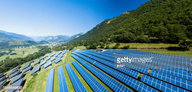 aerial view of solar power station - solar powered station stock pictures, royalty-free photos & images