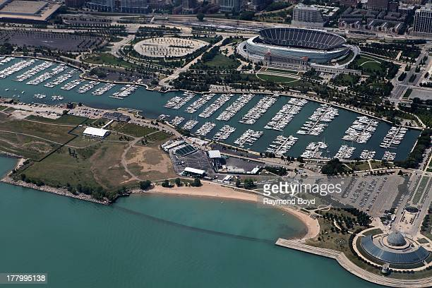Aerial view of Soldier Field Northerly Island and Adler Planetarium, as photographed over Lake Michigan in Chicago, Illinois on AUGUST 15 2013.