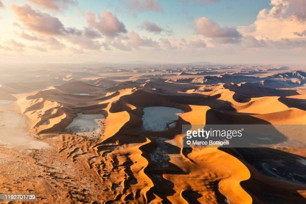 aerial view of sossusvlei sand dunes at sunrise, namibia - namib naukluft national park stock pictures, royalty-free photos & images