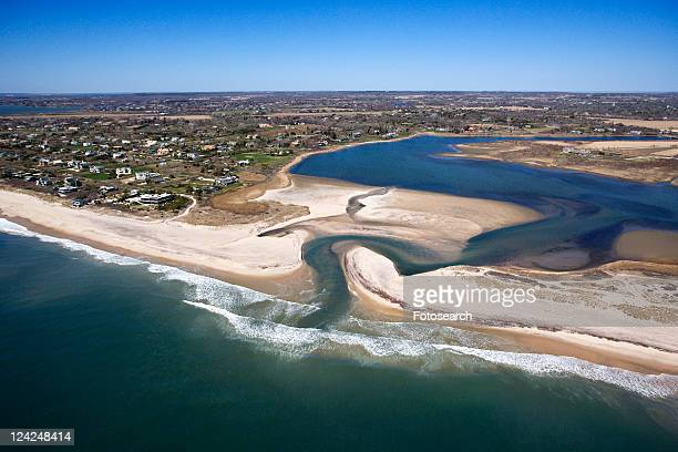 Aerial view of Southampton, New York with shoal and inlet.