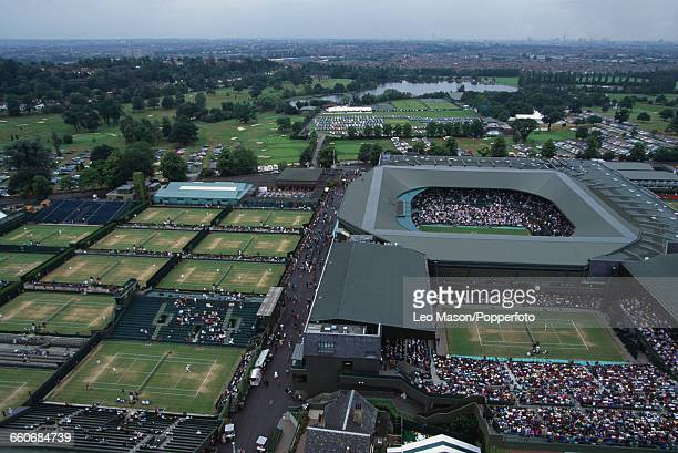 Aerial view of spectators viewing play on Centre Court and other smaller courts during the Wimbledon Lawn Tennis Championships at the All England...