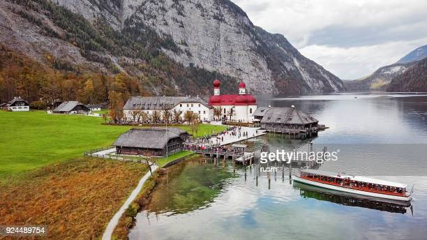 aerial view of st. bartholomew's pilgrimage church on konigsee, berchtesgaden, germany - königssee bavaria stock photos and pictures