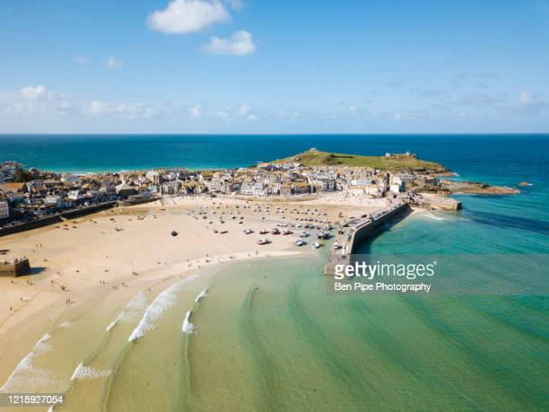 aerial view of st ives, a wide sandy beach and sheltered harbour with boats beach on sand at low tide. - rock formation stock pictures, royalty-free photos & images