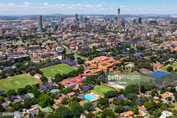 aerial view of st john's college, houghton, johannesburg, south africa - jacaranda tree stock pictures, royalty-free photos & images