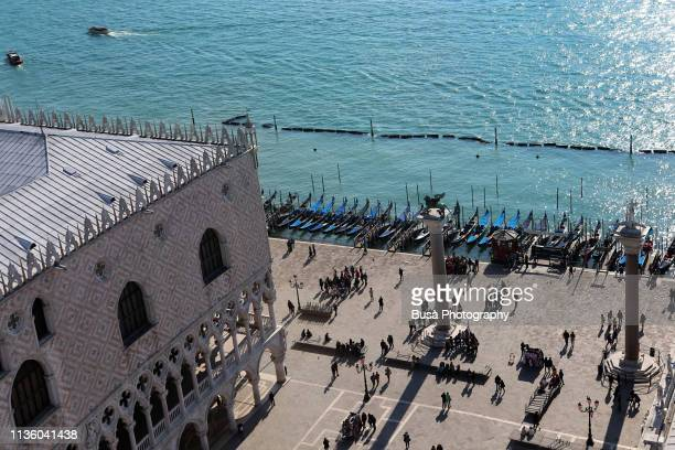 aerial view of st mark's square with the doge's palce and the st. mark's lion facing the venetian lagoon. venice, italy - leone di san marco foto e immagini stock