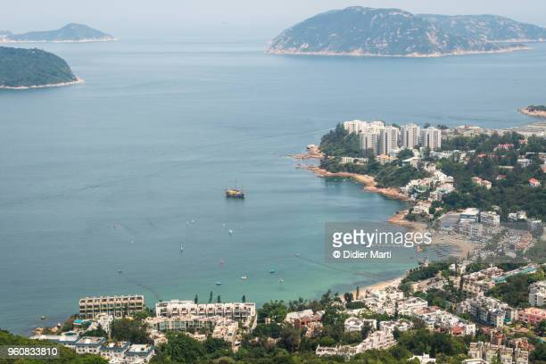 Aerial view of Stanley coastal town and its beach in Hong Kong island on a sunny summer day