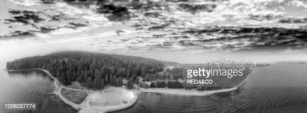 Aerial view of Stanley Park at sunset with Vancouver skyline Canada