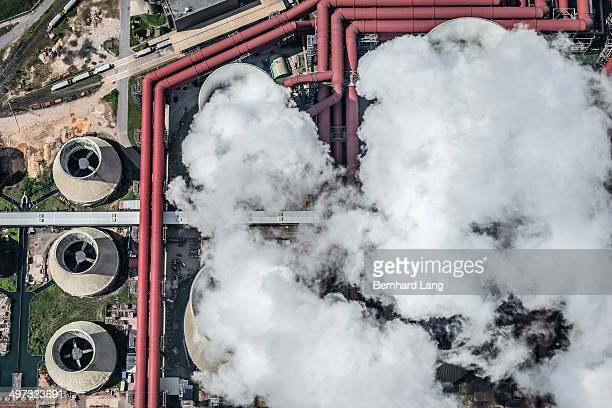 Aerial view of steam coming out of cooling towers