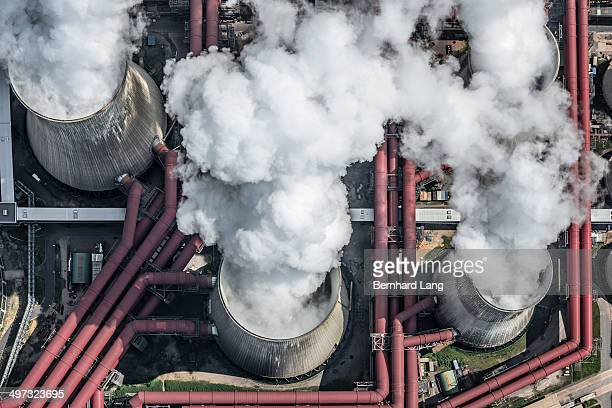 Aerial view of steaming cooling towers
