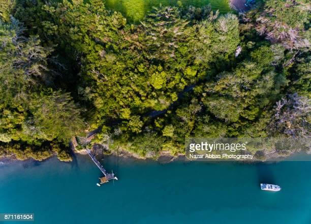 aerial view of stillwater marina. - ファンガパラオア半島 ストックフォトと画像