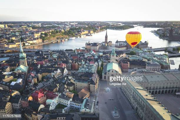 aerial view of stockholm city skyline of gamla stan, riddarholmen and riddarfjarden bay, with hot air balloon floating, sweden - stockholm cathedral stock pictures, royalty-free photos & images