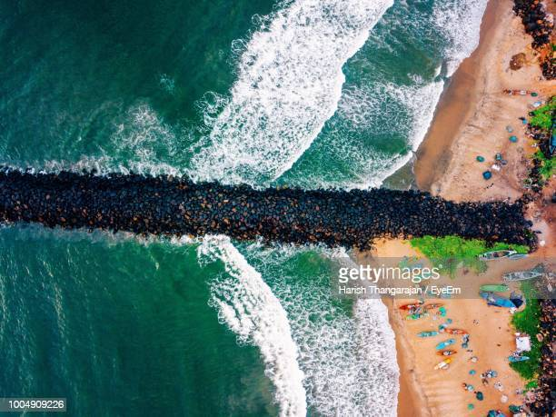 aerial view of stone pier at beach - chennai stock pictures, royalty-free photos & images