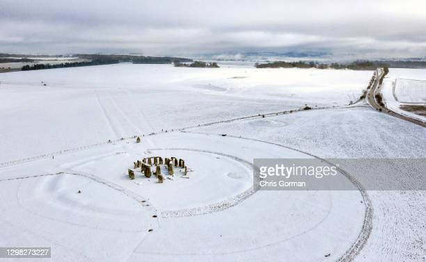 Aerial view of Stonehenge under a blanket of snow on January 24,2021 in Amesbury, England.Parts of the country saw snow and icy conditions as arctic...