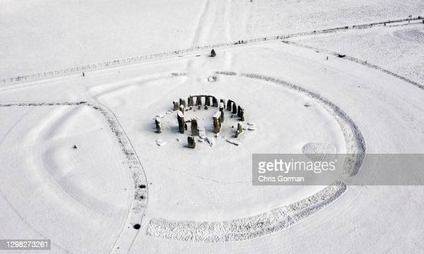 Aerial view of Stonehenge under a blanket of snow on January 24,2021 in Amesbury, England. Parts of the country saw snow and icy conditions as arctic...