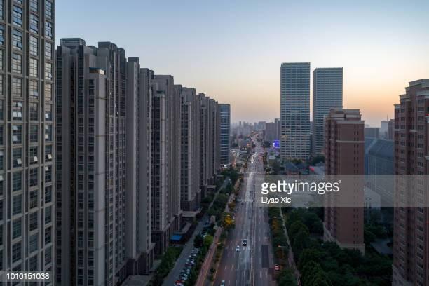 aerial view of street and residential building - liyao xie stockfoto's en -beelden