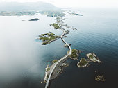 Aerial view of stunning bridge road and small islands in the sea in Norway