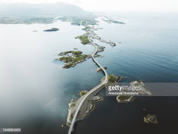 aerial view of stunning bridge road and small islands in the sea in norway - road stock pictures, royalty-free photos & images