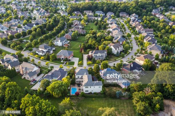 aerial view of suburban neighborhood - district stock pictures, royalty-free photos & images