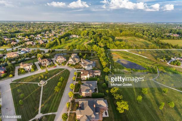 aerial view of suburban neighborhood - indiana stock-fotos und bilder