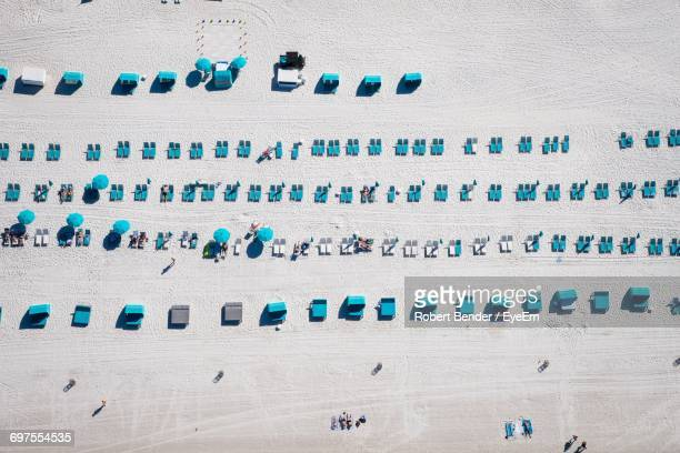 aerial view of sun loungers on beach - naples florida stock pictures, royalty-free photos & images
