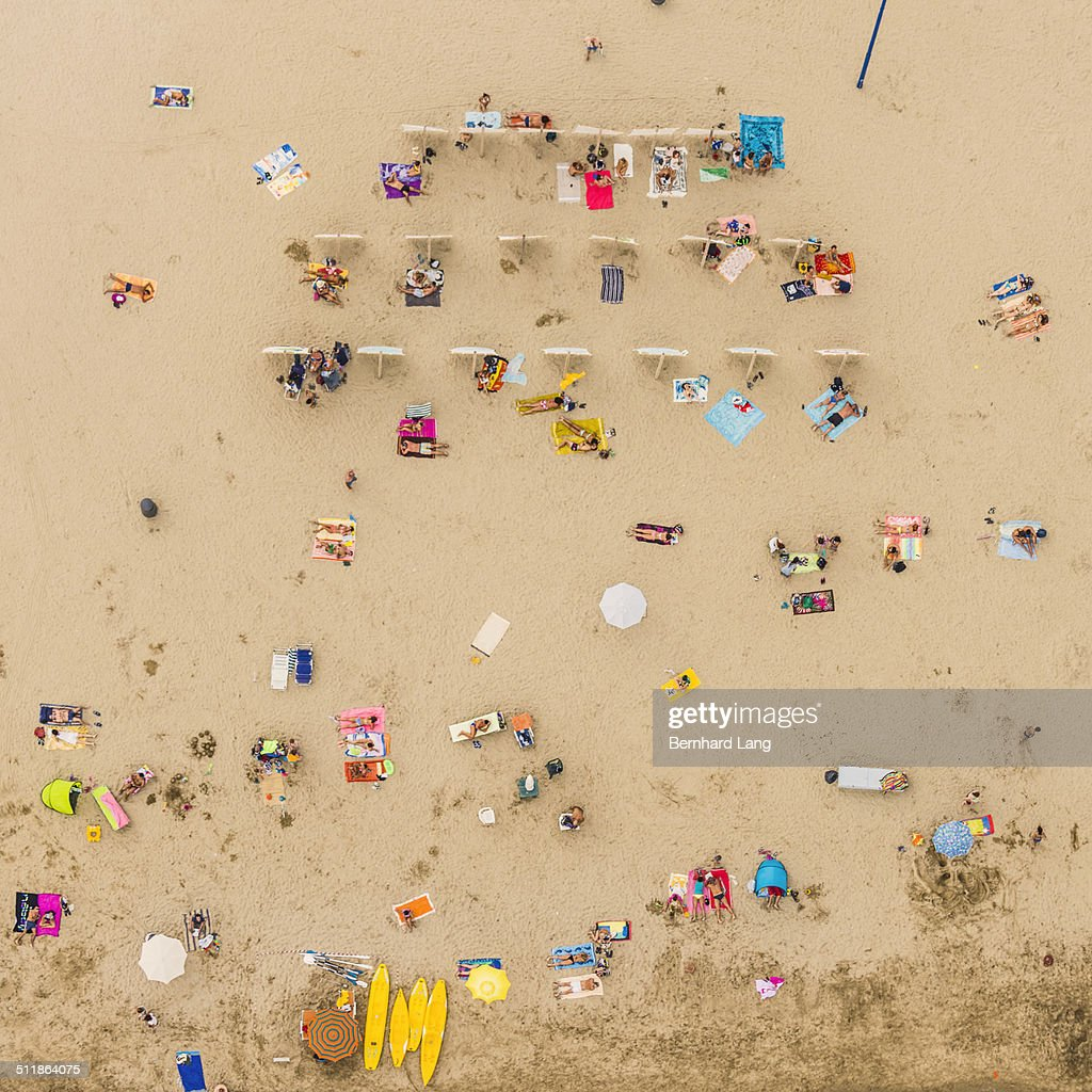 Aerial View of sunbathers lying in sand : Stock Photo