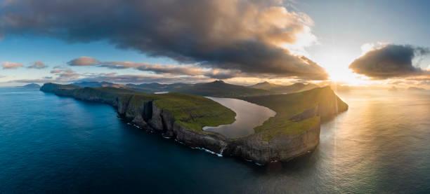 Aerial view of sunrise at Sorvagsvatn or Leitisvatn lake in the island of Vagar. Faroe Islands.