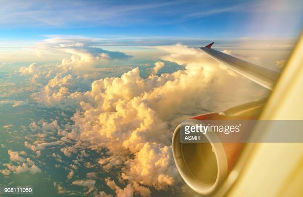 aerial view of sunrise clouds from the sky - plane stock photos and pictures