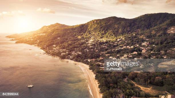 aerial view of sunset in baie beau vallon - mahe - seychelles - catamaran stock photos and pictures