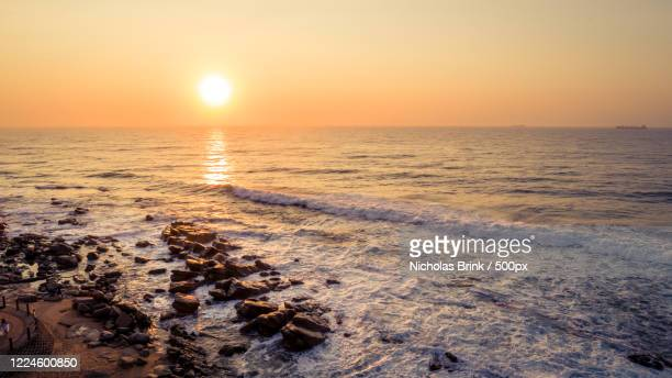 aerial view of sunset over rocky beach, durban, south africa - durban stock pictures, royalty-free photos & images
