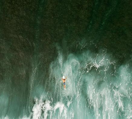Aerial View of Surfer surfing waves - gettyimageskorea