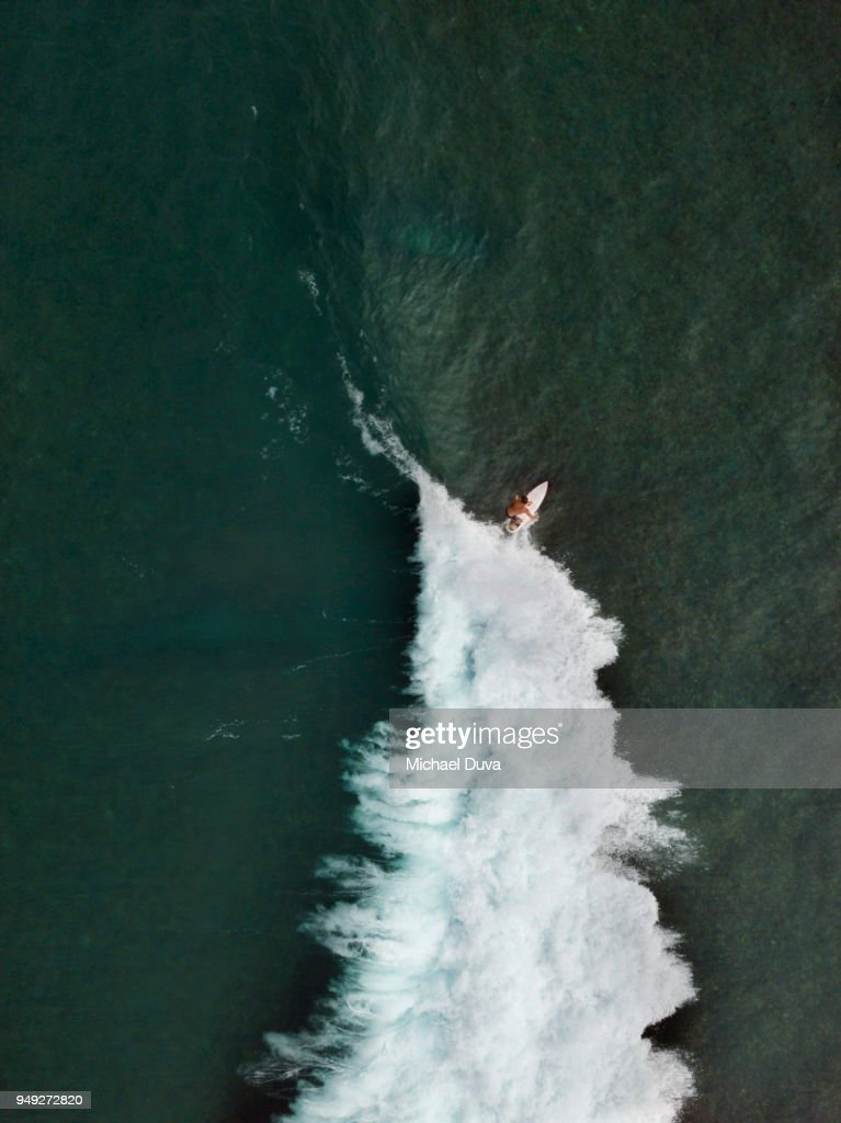 Aerial View of Surfer surfing waves : Stock Photo