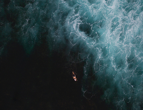 Aerial View of Surfer surfing waves - gettyimageskorea
