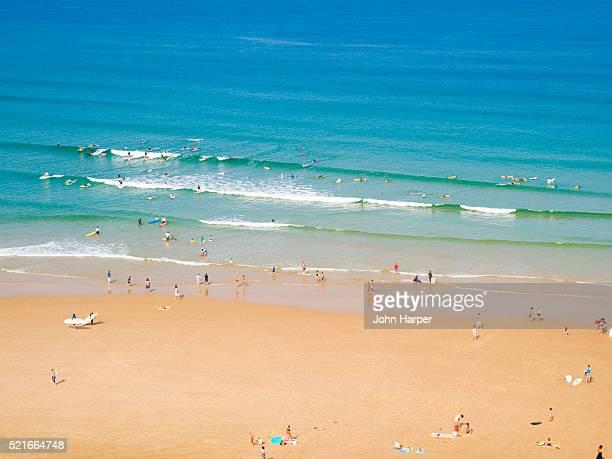 Aerial view of surfers on Plage de la Cote des Basques, Biarritz, Aquitaine, France