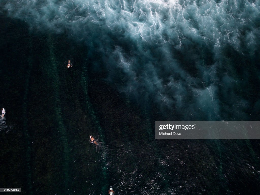 Aerial View of Surfers surfing waves : Stock Photo