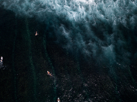 Aerial View of Surfers surfing waves - gettyimageskorea