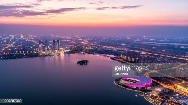 aerial view of suzhou jinji lake at dusk - suzhou stock pictures, royalty-free photos & images