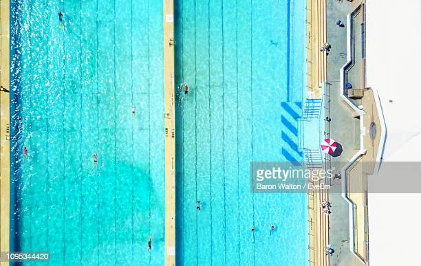 aerial view of swimming pool during sunny day - wollongong stock pictures, royalty-free photos & images