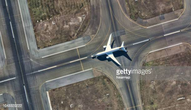 aerial view of sydney international airport. australia - airport runway stock pictures, royalty-free photos & images