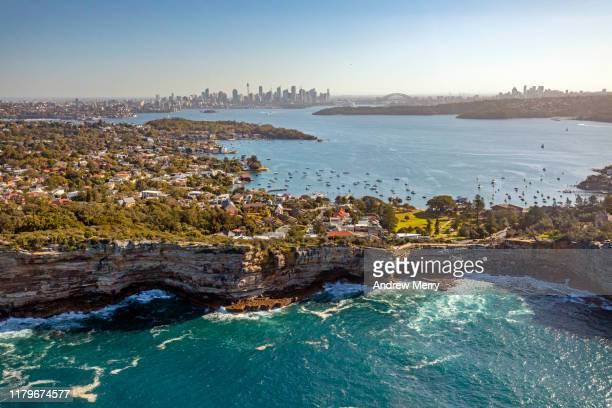 aerial view of sydney with sea cliffs, the gap, watsons bay, suburbs, sydney harbour and city skyline, australia - baia foto e immagini stock